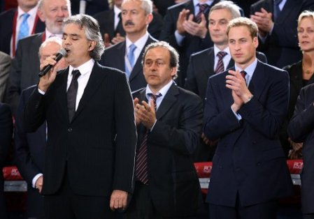 Italian Opera singer Andrea Botticelli (left) sings of UCL anthem to the match- UEFA President, Michel Platini(middle) and Prince William(right)