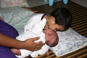 Adam showing his love to his little sister.. Nursafirah Auni...