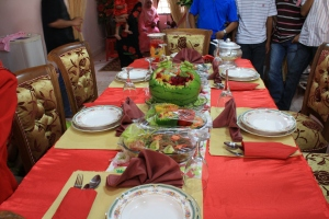 <i>Feasting table at his home</i>